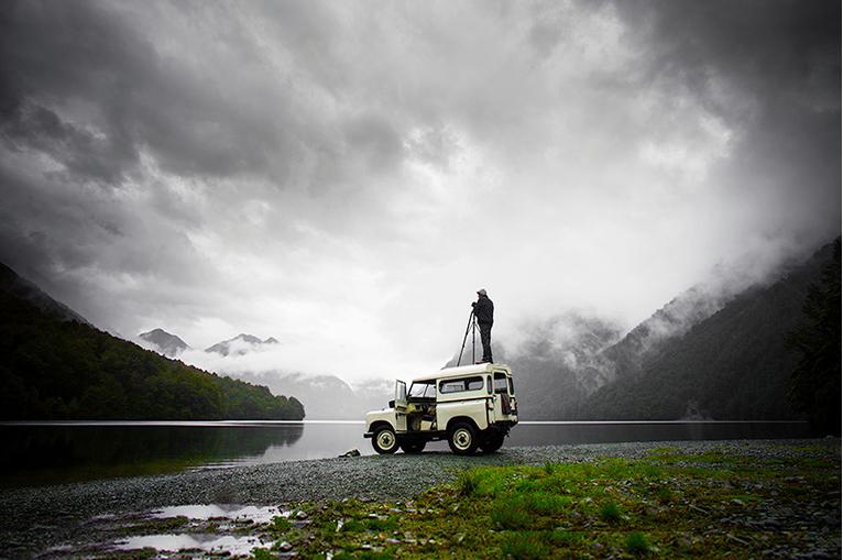Man photographic atop a Range Rover