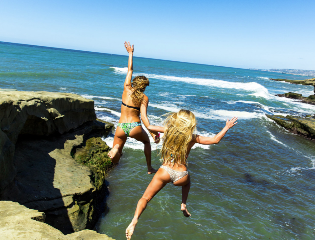 Girls jumping off a cliff