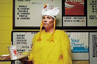Humorous photo of woman dressed up as a chicken.