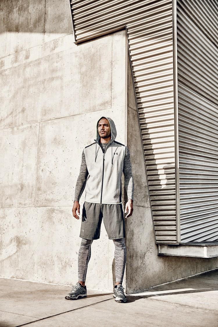 Athlete standing at concrete corner