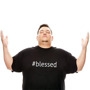 Photo of man holding up hands in praise