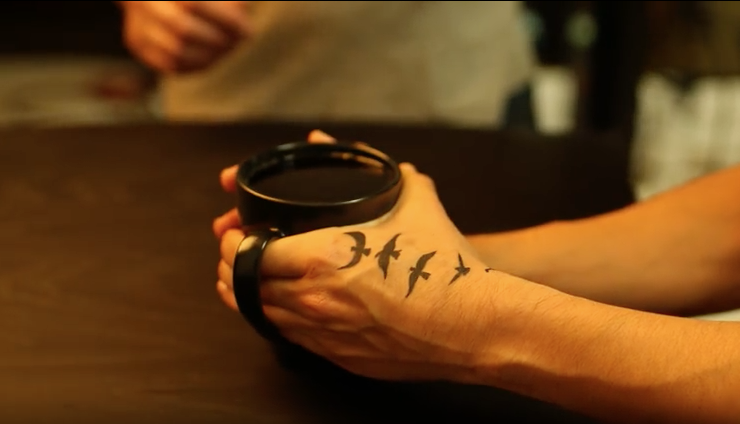 Peet's Coffee in Hand with tattoo