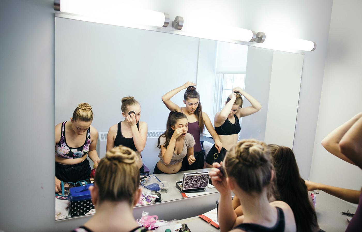 Ballet dancers putting on makeup