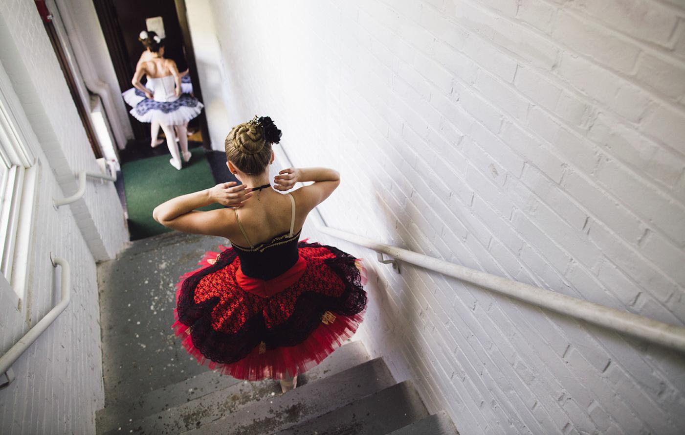 Ballet dancers running downstairs