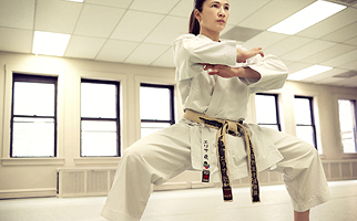 Woman in karate stance.