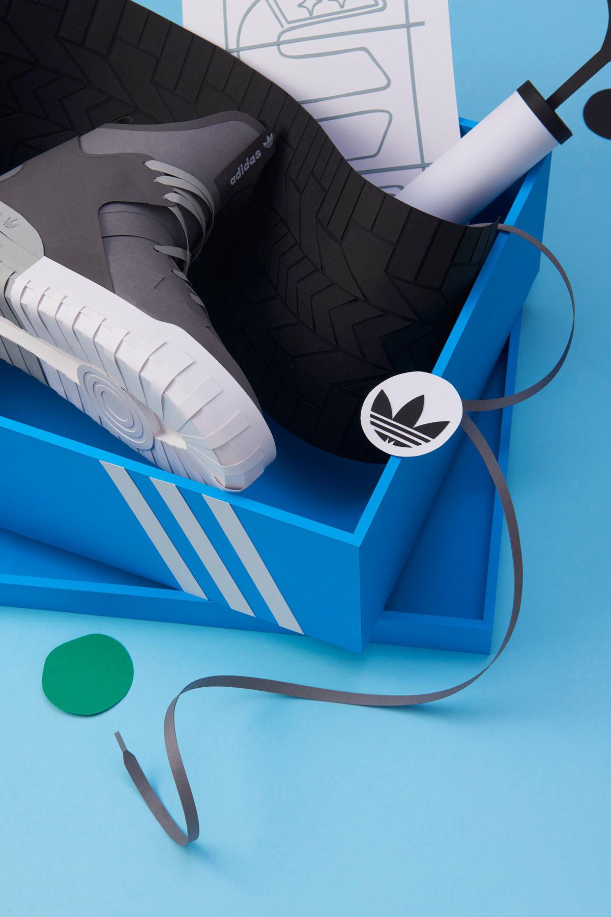 Paper sculpture of Adidas tennis shoe.