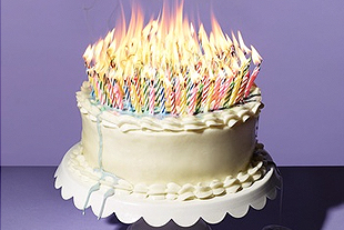 Birthday cake with a hundred candles.