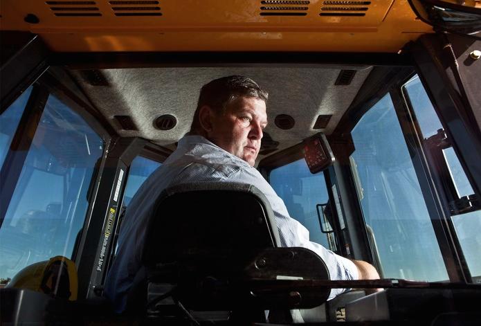 Man driving heavy machine