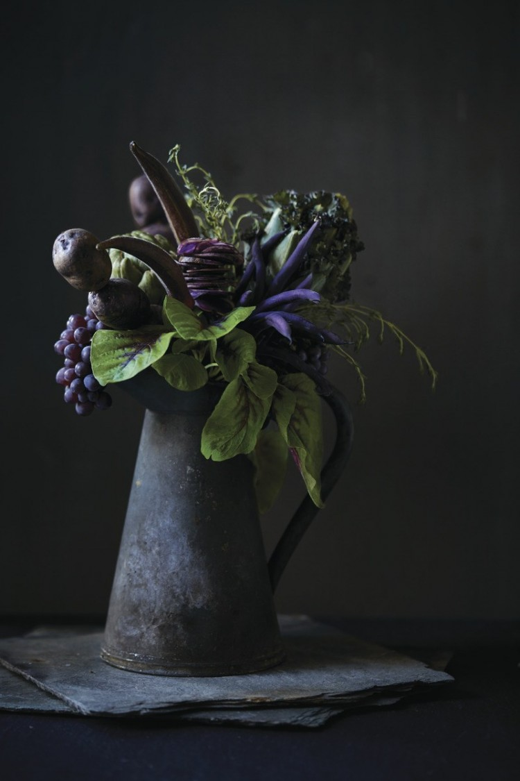 Flower and fruit arrangement in watering can