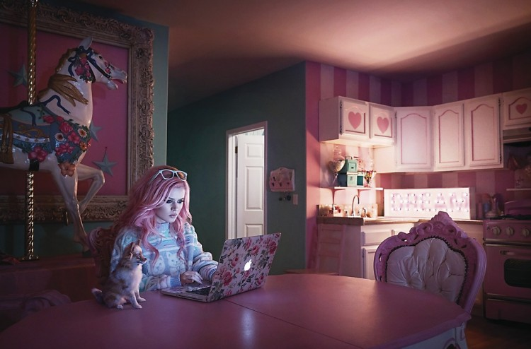Girl in pink room with pink dog