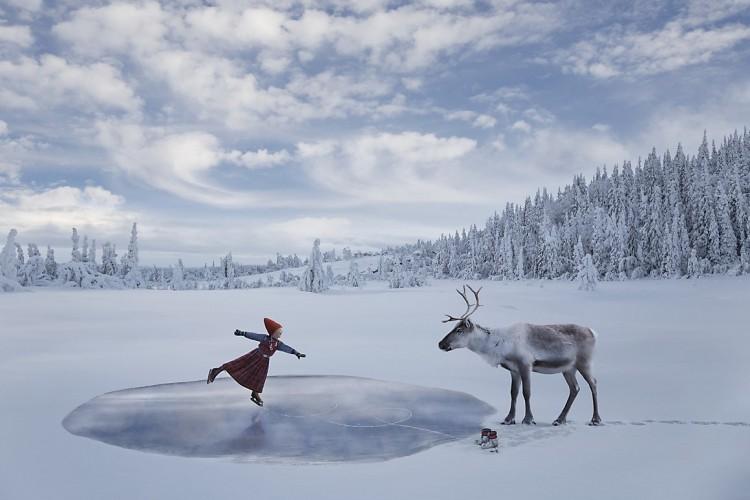 Girl Skating on pond with Reindeer