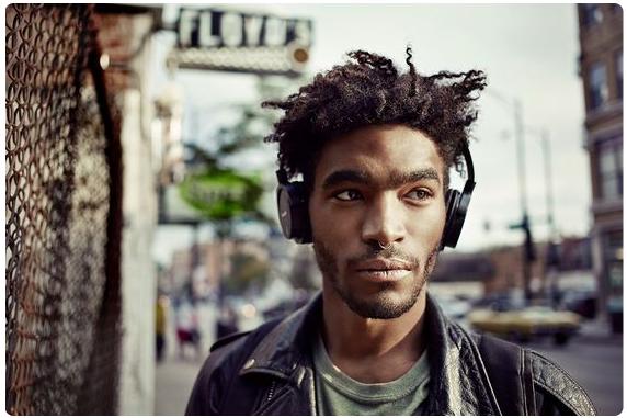 Black man on street with headphones