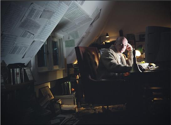 Man at his desk at night