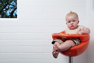 Toddler in high chair.